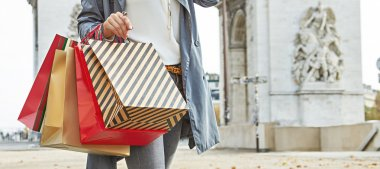 modern woman shopper in Paris, France using smartphone shopper