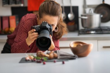 Young woman photographing food stock vector
