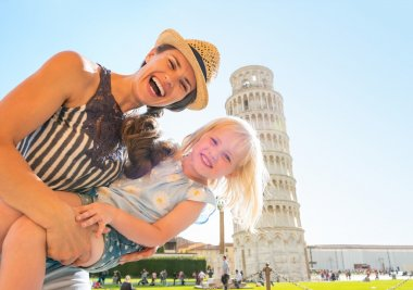 Portrait of mother and baby girl in front of leaning tower of pi