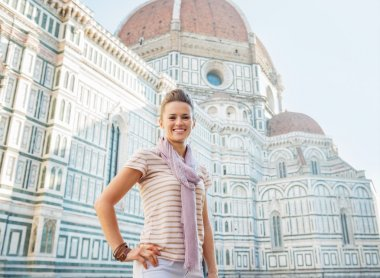 Portrait of happy young woman standing in front of cattedrale di santa maria del fiore in florence, italy stock vector