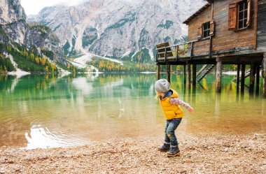 Young girl on Lake Bries  in the autumn skipping stones