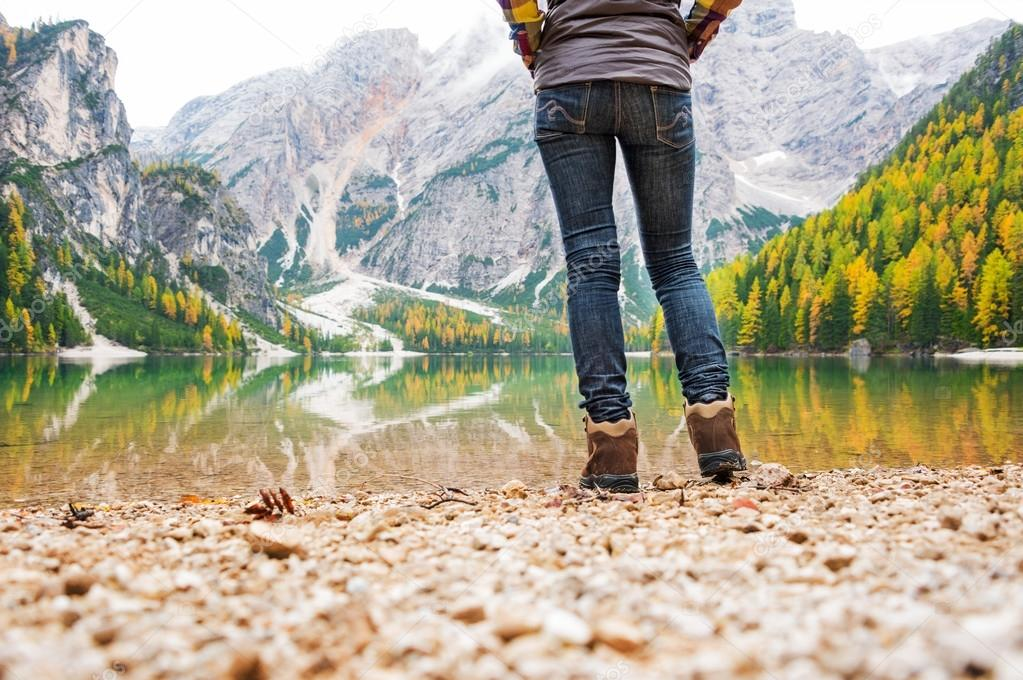Closeup leg shot of woman hiker on the shores of Lake Bries