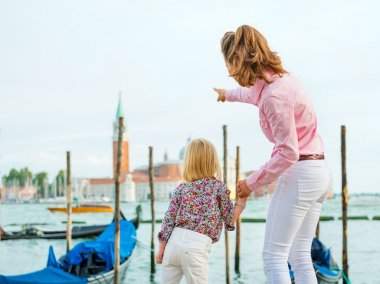 Mother pointing out San Giorgio Maggiore church to daughter