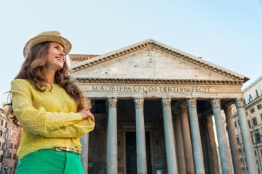 A young brunette woman smiles as she looks into the distance, arms crossed, with the Pantheon in Rome in the background. stock vector