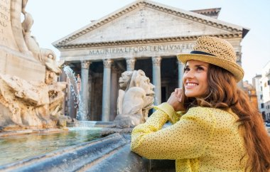 A smiling, happy brunette is standing by the Pantheon fountain. stock vector