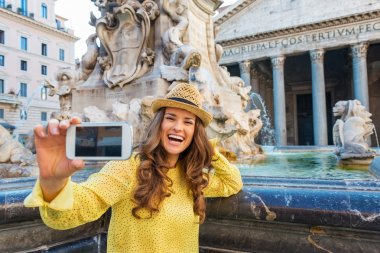 Laughing woman tourist taking photo at Pantheon fountain in Rome