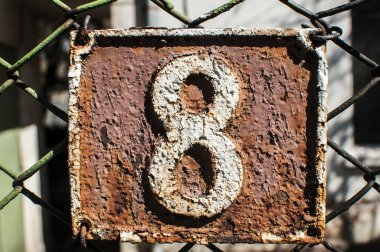 Old retro cast iron plate number 8