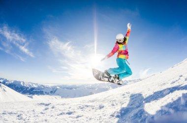 Girl having fun on her snowboard jumping stock vector