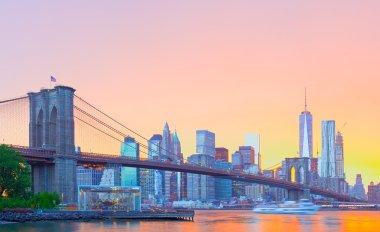 New York City, Manhattan downtown panorama with famous landmark Brooklyn Bridge