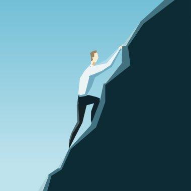 Businessman climbing on top of mountain