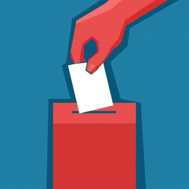 Hand puts ballot in ballot box