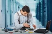 Man fixing the laptop