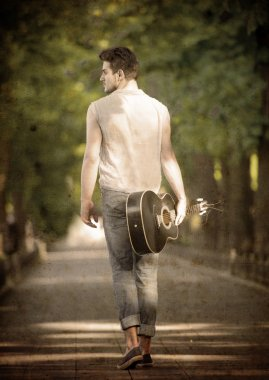 Walking man with a guitar