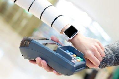 Customer paying  by smart watch