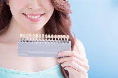 woman holding  teeth sample