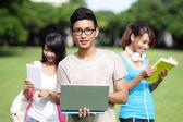 Fotografie Happy College students using computer