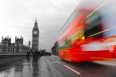 Red bus in motion and Big Ben