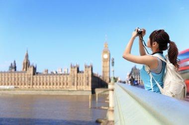 Woman traveler take photo in London
