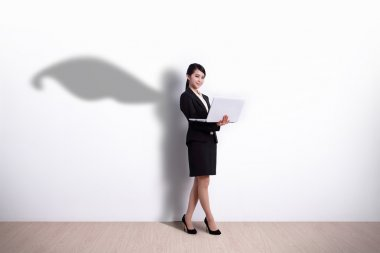 Business Woman holding computer
