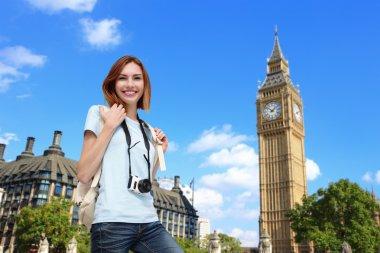 Happy  woman standing in London
