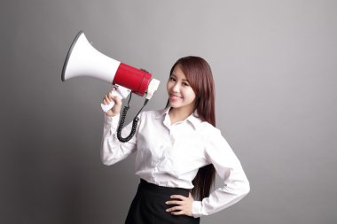 Business woman screaming with megaphone