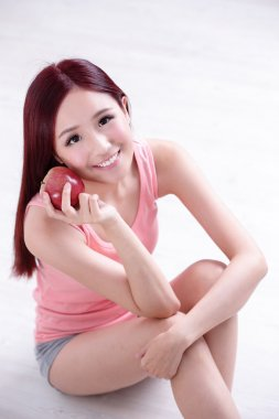 Healthy girl holding  Apple
