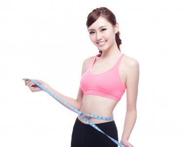 Sporty  girl holding  measure tape