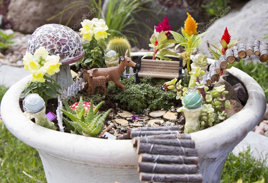 Fairy garden in a flower pot outdoors