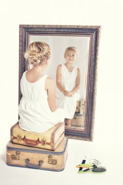 Child or young girl in front of a mirror