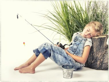 Child or young girl taking a nap or sleeping while fishing