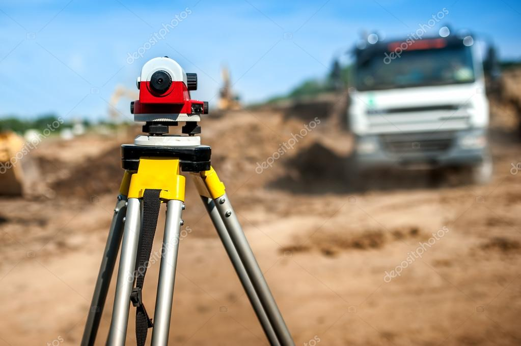 Surveyor engineering equipment with theodolite at highway infrastructure construction site