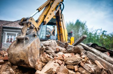 Hydraulic crusher excavator backhoe machinery working on site demolition
