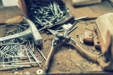 Home garden tools with industrial scissors, hammer, nails and other tools in workshop