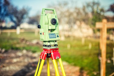 surveyor engineering equipment with theodolite and total station at a construction site