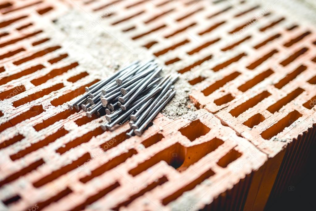 Nails And Tools On Construction Site Bricks Layer And