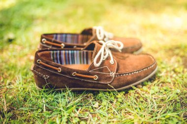 mens brown leather shoes, suede leather. mens fashion concept, brown mocassins ready for catalog and sale