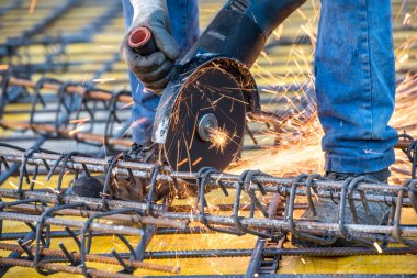 close-up details of construction engineer worker cutting steel bars and reinforced steel at building site