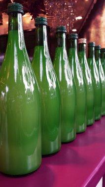 Harvest Festival. Row of New Wine in Green Bottles for Sale