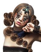 Fotografie Fantasie. Fancy-Frau mit kreativen Make-up und Tränen