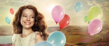 Holiday. Happy Woman with Colorful Air Balloons