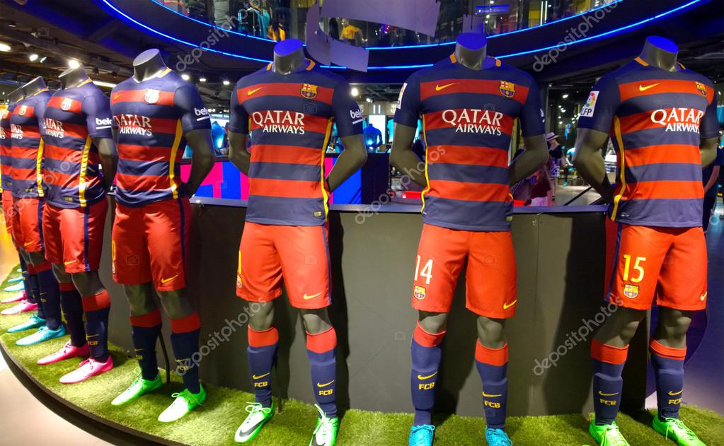 b672f3791 BARCELONA, SPAIN - OCTOBER 13: FC Barcelona kits in FC Barcelona Shop,  Spain on October 13, 2015 FC Barcelona Store is the official store of  shirts, ...