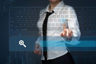 Young girl pressing virtual type of keyboard