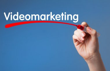 Hand writing Video Marketing red marker on transparent wipe boar