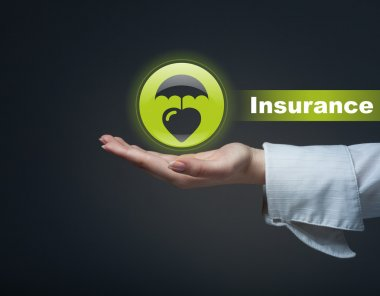 Business insurance concept. Man holding a symbol of life insuran