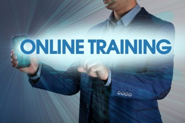 Businessman presses button online training on virtual screens. B