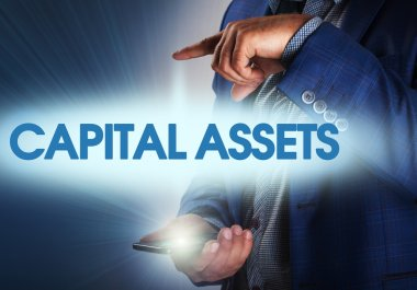 Businessman presses button capital assets on virtual screens. Bu
