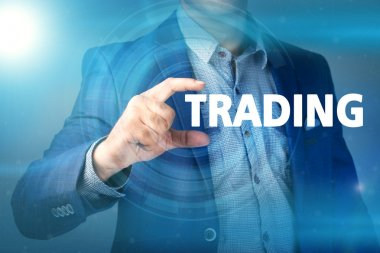 Businessman presses button trading on virtual screens. Business,