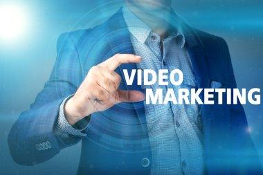 Businessman presses button video marketing on virtual screens. B