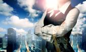 Double exposure of businesswoman and city. Business, technology,