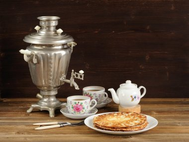 Russian bliny with vintage samovar and teaware